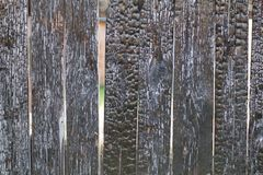 Old burned wooden fence royalty free stock photos