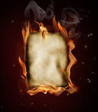 Old burning blank paper. S on black background Stock Images