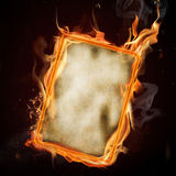Old burning blank paper. S on black background Stock Photo
