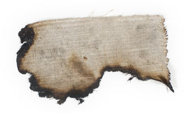 Old burnt burlap on a white surface
