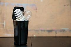 Old burnt fluorescent energy saving lamps. Hazardous and toxic electronic waste stock photography