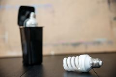 Old burnt fluorescent energy saving lamps. Hazardous and toxic electronic waste stock images