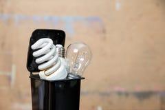 Old burnt fluorescent energy saving lamps. Hazardous and toxic electronic waste royalty free stock photos