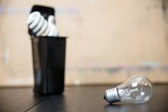 Old burnt fluorescent energy saving lamps. Hazardous and toxic electronic waste stock photo