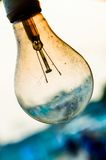 Old burnt lamp smoked inside. Royalty Free Stock Image