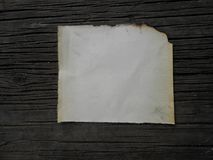 Old burnt paper vintage. Old burnt paper on wooden boards vintage,  in grunge style Royalty Free Stock Photos
