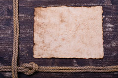 Old burnt paper. On wood with rope frame background royalty free stock photos