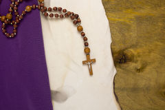 Old burnt parchment with a Catholic cross Royalty Free Stock Photos