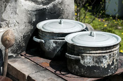 Old burnt soot enameled saucepots Royalty Free Stock Images