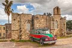 Old bus and old church Stock Photography