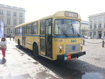 Old bus in Royal place, brussels, belgium. Old yellow bus Royalty Free Stock Photos