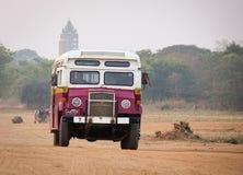 An old bus running rural road in Bagan, Myanmar.  Royalty Free Stock Image
