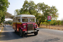An old bus running on rural street in Bagan Stock Photography
