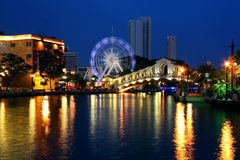 Old bus station bridge. Night view of Melaka river in Malaysia Stock Photo