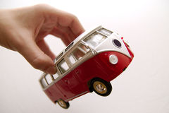 An old bus toy in hands. Isolated Royalty Free Stock Photos