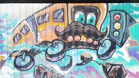 Old bus furious on street. Graffiti Stock Photos