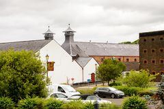 Old Bushmills Whiskey Distillery. BUSHMILLS, NI - JULY 15, 2016: Old Bushmills Whiskey Distillery. It is a popular tourist attraction royalty free stock image