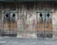 Old Business Doors in French Quarter of New Orleans. A pair of doors from an abandoned business in the French Quarter of New Orleans in Louisiana Royalty Free Stock Photo
