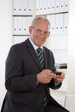 Old Business Man At Telephone Stock Photo