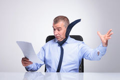 Old business man blown off by documents Royalty Free Stock Photo