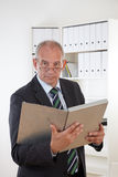 Old business man with clipboard Stock Images