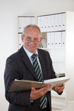 Old business man with clipboard Royalty Free Stock Image