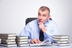 Old business man at desk looks to side Stock Images