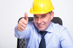 Old business man with helmet shows ok stock photos