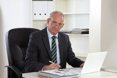 Old Business man with Laptop Stock Image