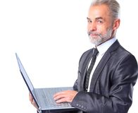 Old Business man with Laptop Royalty Free Stock Photography