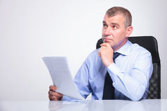 Old business man is pensive at office Stock Image