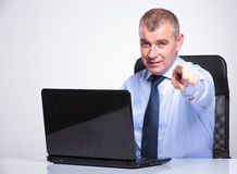 Old business man points at you from laptop Royalty Free Stock Photo