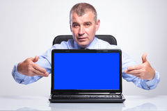 Old business man presents his laptop Stock Photo