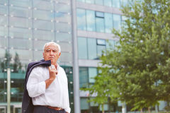 Old business man standing outside Royalty Free Stock Images
