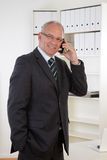 Old Business man at telephone Stock Photography