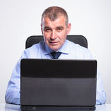 Old business man working at laptop Royalty Free Stock Image