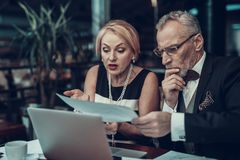 Old Business people looking at Graphics royalty free stock photography