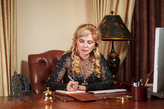 Old Business woman at the desk Stock Image