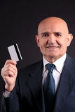 Old businessman with credit card and mobile Stock Photos