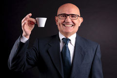 Old businessman with a cup of coffee Stock Photography