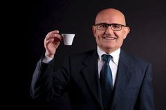 Old businessman with a cup of coffee Stock Images