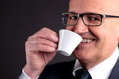 Old businessman with a cup of coffee Royalty Free Stock Photos