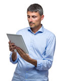 Old businessman looking at digital tablet Stock Photography