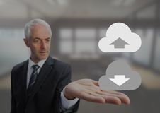 Old Businessman with open palm hands holding upload download cloud icons. Digital composite of Old Businessman with open palm hands holding upload download cloud Stock Photos
