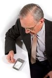 Old businessman with pocket pc Stock Image