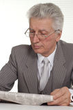 Old businessman reading a newspaper Royalty Free Stock Photography