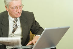 Old businessman sitting Royalty Free Stock Image