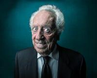 Old businessman smiling Stock Image