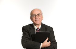 Old businessman with tablet computer stock image