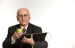 Old businessman with tablet computer royalty free stock images